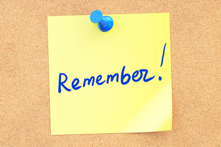 Remember text on a sticky note pinned to a corkboard. 3D rendering Stock Photo