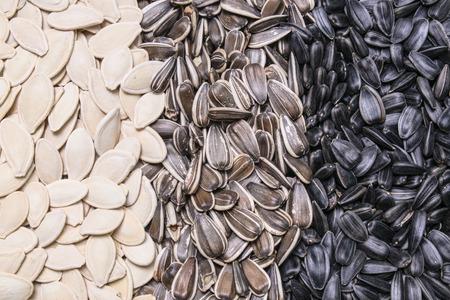 sunflower seeds: sunflower seeds and pumpkin seeds background, texture Stock Photo