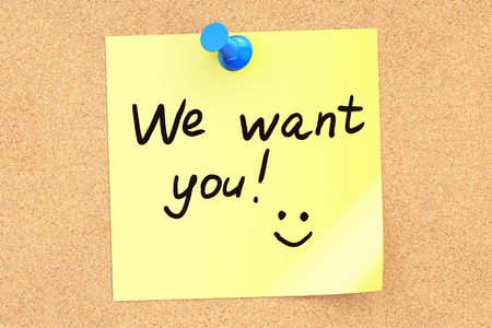 pinned: We want you! Text on a sticky note pinned to a corkboard. 3D rendering Stock Photo