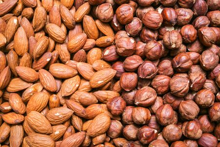 purified: Peeled almonds and hazelnuts background or texture Stock Photo