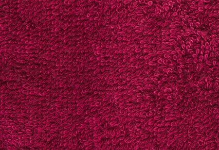 toweling: Terrycloth red, closeup fabric texture background. High resolution