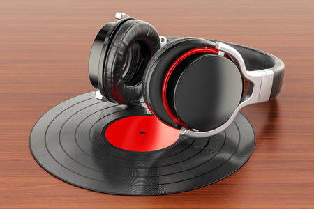 Headphones with vinyl record on the wooden table. 3D rendering