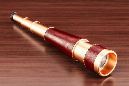Spyglass, brass hand held telescope on the wooden table. 3D rendering Stock Photo