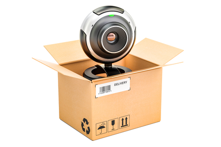 Webcam inside parcel, delivery concept. 3D rendering isolated on white background Stock Photo