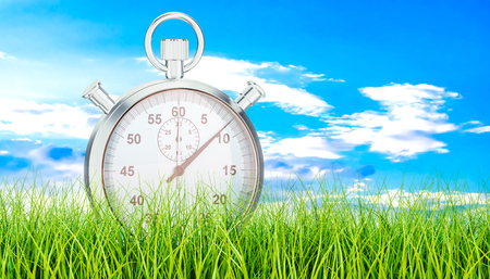 Silver stopwatch, chronometer on green grass. 3D rendering Stock Photo