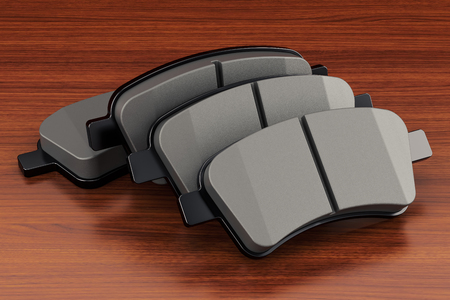 Brake pads on the wooden table. 3D rendering