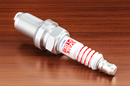 Spark plug on the wooden table. 3D rendering