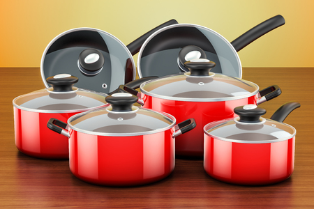 Set of cooking red kitchen utensils and cookware. Pots and pans on the wooden table. 3D rendering