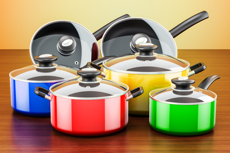 Set of colored cooking kitchen utensils and cookware. Pots and pans on the wooden table. 3D rendering  Stock Photo