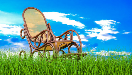 Rocking chair in green grass against blue sky, 3d rendering