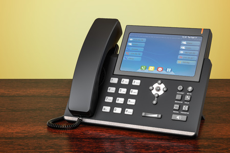 Modern IP Phone on the wooden table. 3D rendering  Archivio Fotografico