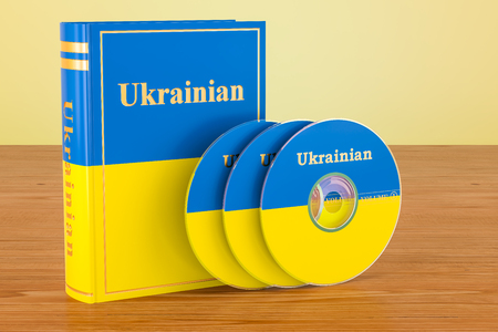 Ukrainian language textbook with flag of Ukraine and CD discs on the wooden table. 3D rendering