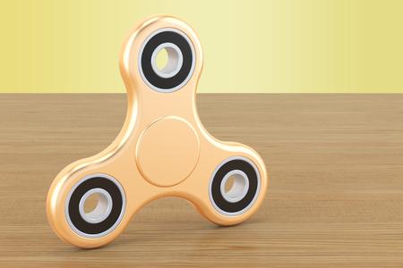 Golden Fidget Spinner on the wooden table. 3D rendering