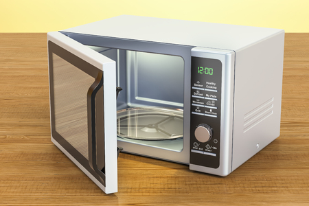 Microwave on the wooden table. 3D rendering Banco de Imagens