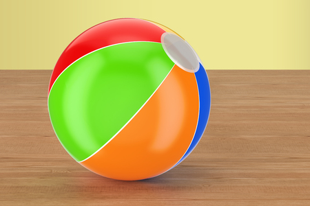 Beach ball on the wooden table. 3D rendering
