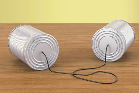 Tin cans telephone on the wooden table. 3D rendering Stock Photo