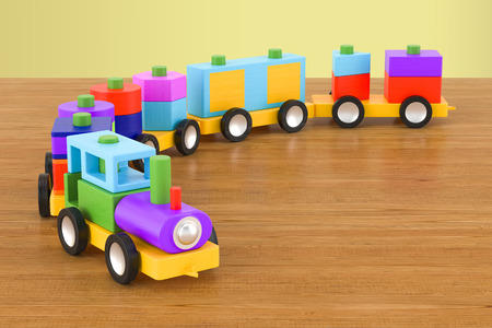 Wooden toy train with colorful blocs on the wooden table. 3D rendering