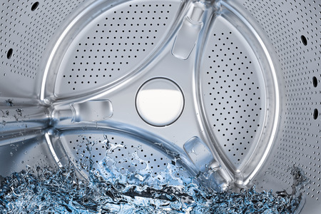 Inside washing machine, drum of front-loading washing machine with water closeup, 3D rendering