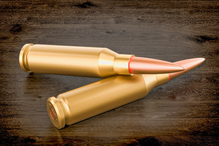 Bullets on the wooden table, 3D rendering Stock Photo