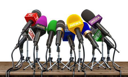 Microphones of different mass media, radio, tv and press for press conference or interview on the wooden table. 3D rendering Stockfoto - 102771247