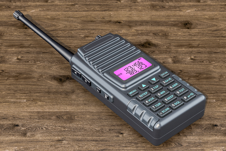 Portable radio walkie-talkie on the wooden table, 3D rendering 写真素材