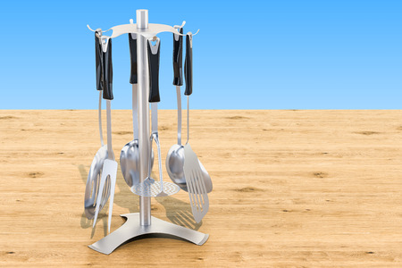 Kitchen utensils with stand on the wooden table, 3D rendering isolated on white background Stock Photo