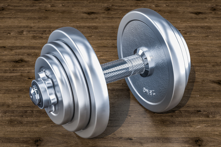 Dumbbell on the wooden background, 3D rendering Stock Photo
