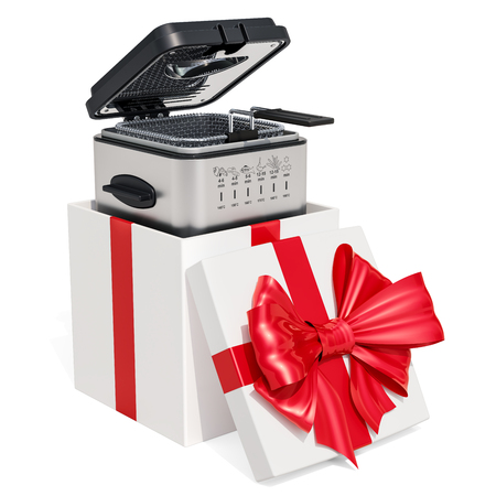 Domestic deep fryer inside a gift box, gift concept. Stock Photo