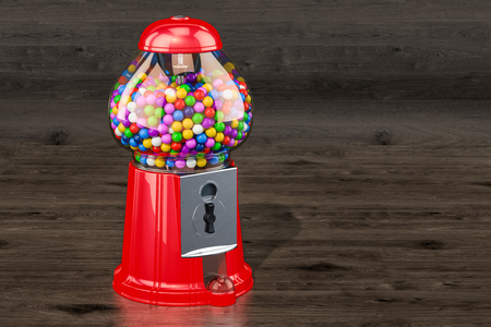 Gumball machine, gum dispenser on the wooden background. Banque d'images - 105413366