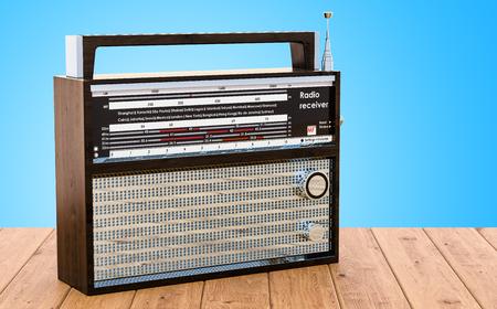 Radio receiver on the wooden desk, 3D rendering