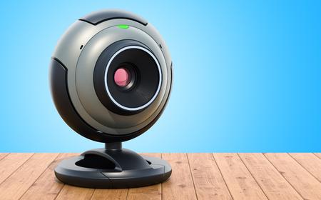 Webcam en la mesa de madera. Representación 3D