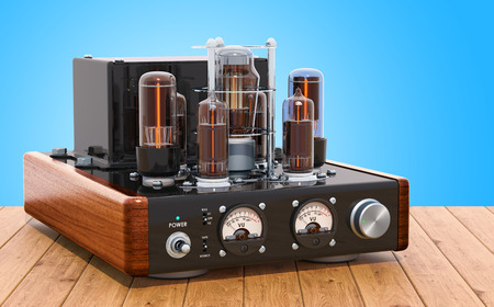 Vintage vacuum tube amplifier on the wooden table. 3D rendering