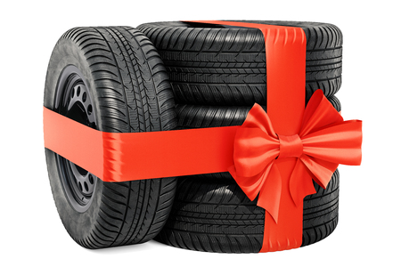 Car wheels wrapped ribbon and bow, gift concept. 3D rendering isolated on white background