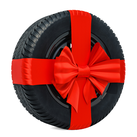 Car wheel wrapped ribbon and bow, gift concept. 3D rendering isolated on white background