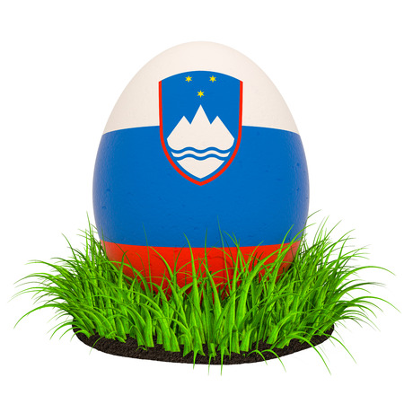 Easter egg with flag of Slovenia in the green grass, 3D rendering isolated on white background