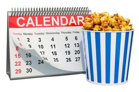 Desk calendar with popcorn container. Movie releases calendar concept, 3D rendering isolated on white background