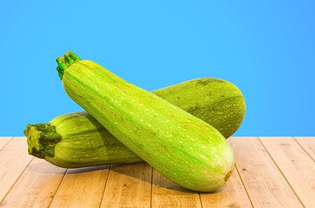 Courgettes or zucchini close-up 3d rendering with realistic texture on the wooden table Zdjęcie Seryjne