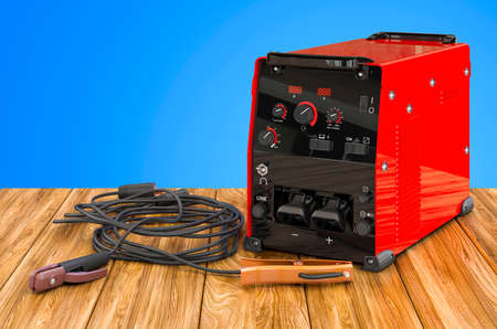 Welding machine with stick electrode holder, work cable and clamp on the wooden table. 3D rendering