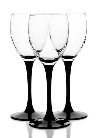 three glasses on the black-legged on a white background photo