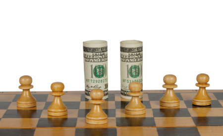 Twisted dollars of chess pieces isolated on white background photo