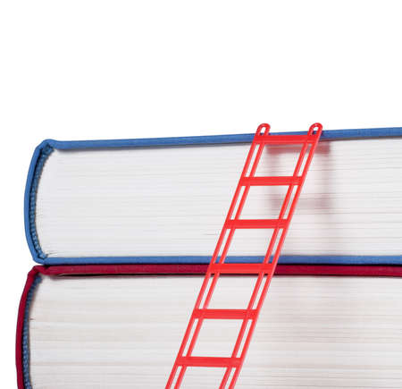Books with a red ladder isolated on white background Stock Photo - 13464528