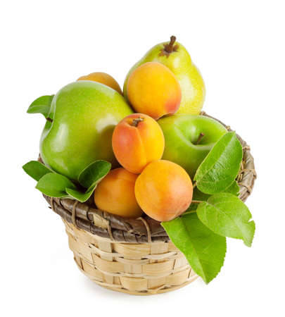 A basket of summer fruit isolated on a white background photo