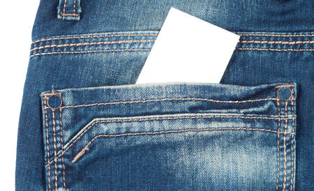 Back pocket of blue jeans with a white card isolated on white background Standard-Bild