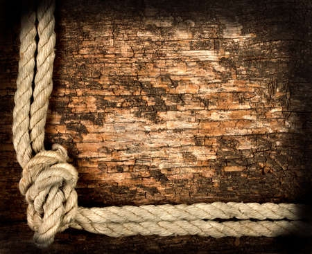 Background of old dried rough planks with rope photo