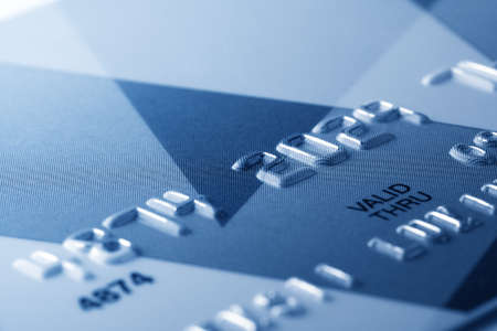 Fragment of credit card toned in blue color