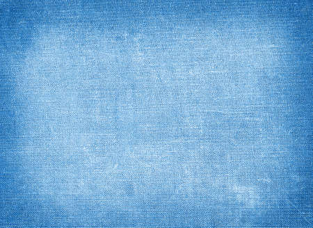 Background of blue coarse textiles with tinted edges