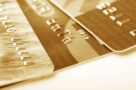 mastercard: Three credit cards in a golden color Stock Photo