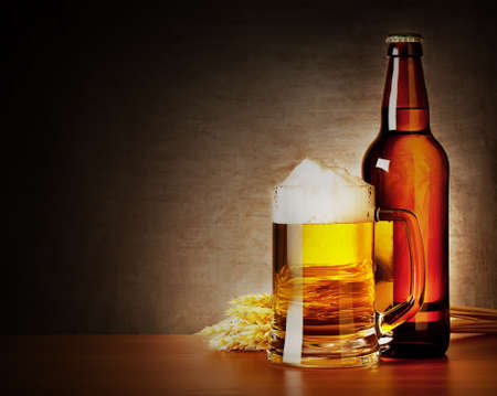 spikelets: Mug of beer and a bottle with spikelets Stock Photo