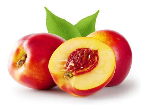 Ripe juicy nectarine with leaves isolated on white background