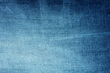 scuffed: Background of bright blue denim with stripes and scuffed